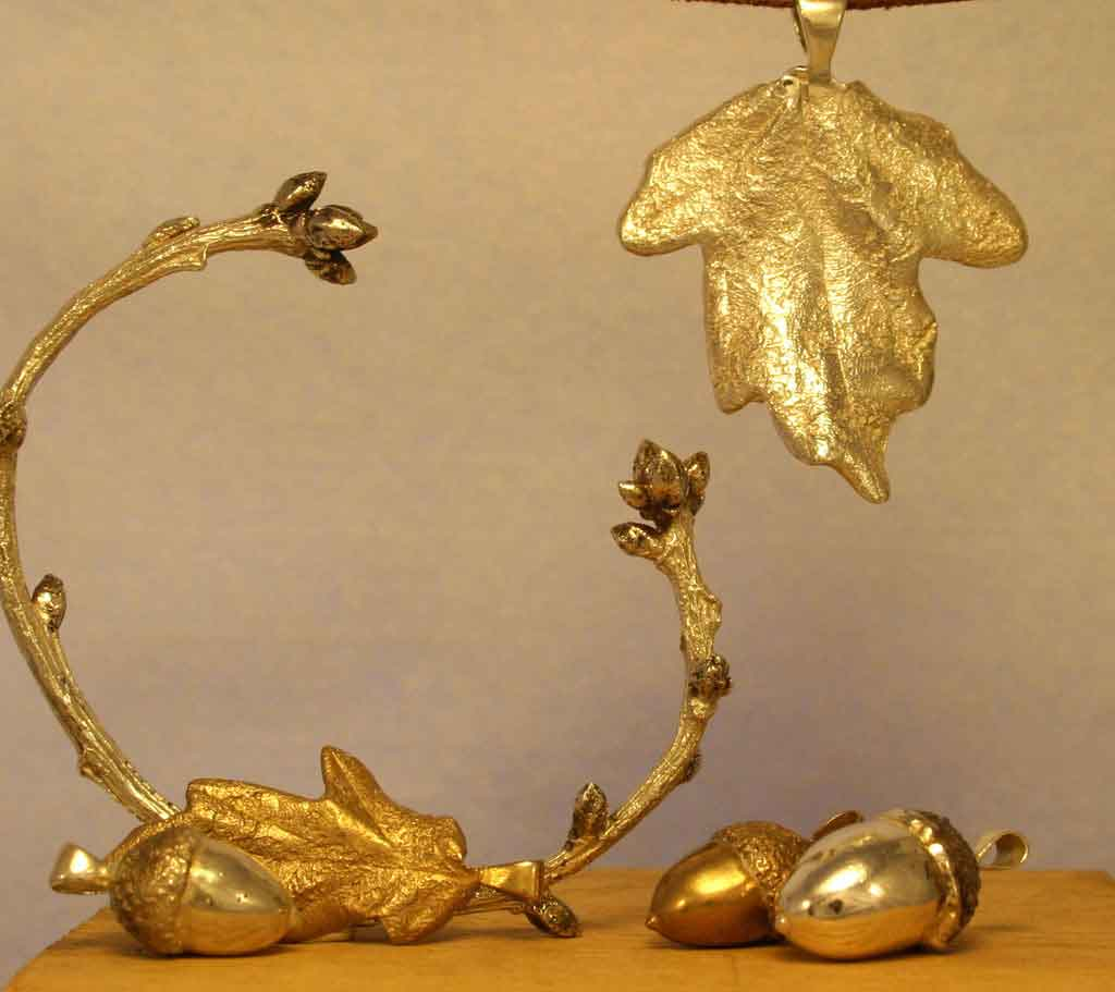 Cast silver and bronze acorns and leaves